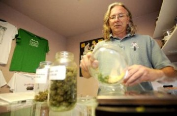 Mark Rose, owner of the Grateful Meds dispensary in Nederland, weighs out an eighth of an ounce of medical marijuana for a client.