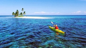 Kayaking to an island in Belize